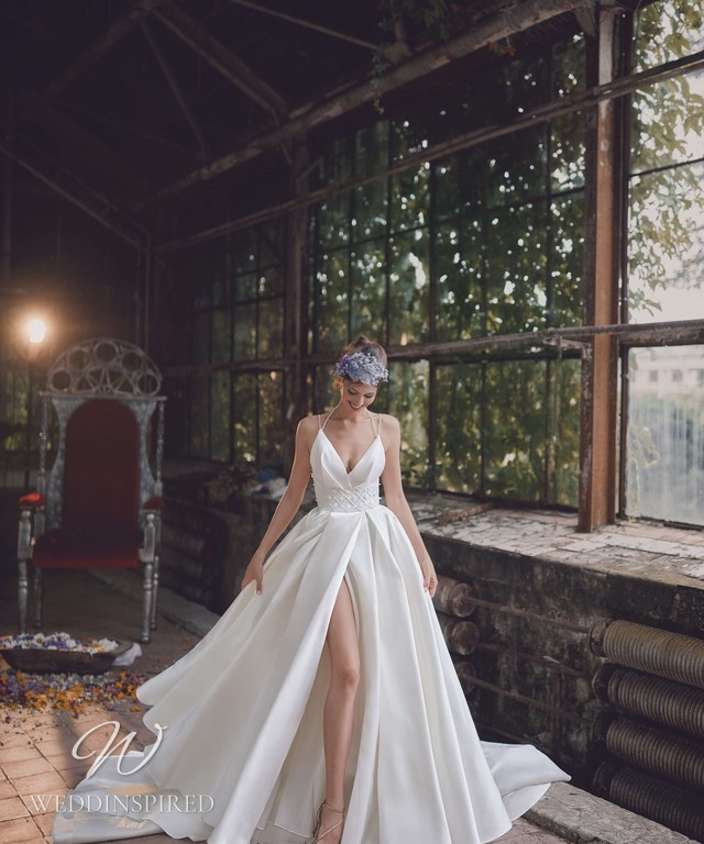 An Ange Etoiles 2021 silk ball gown wedding dress with a high slit and thin spaghetti straps