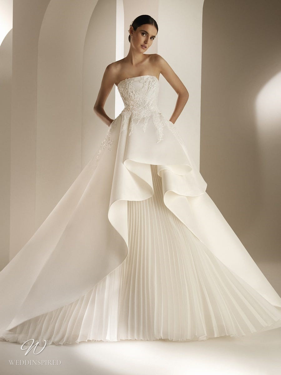 An Atelier Pronovias strapless ball gown wedding dress with a pleated skirt and embroidery