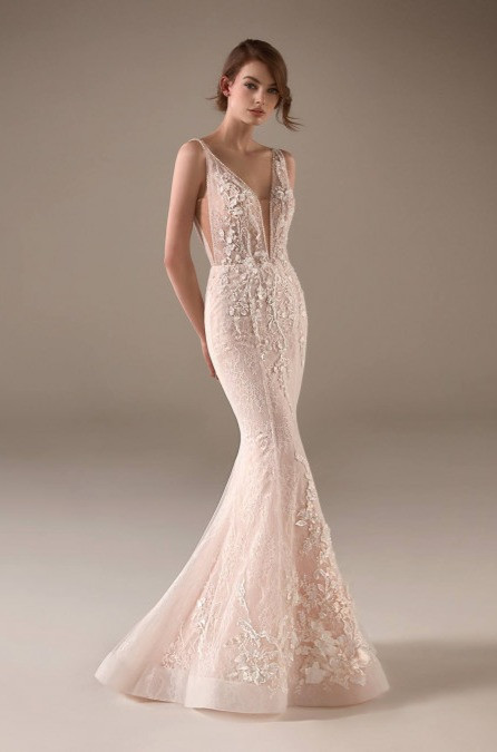 A Pronovias blush mermaid wedding dress, with lace, straps and a low v neckline