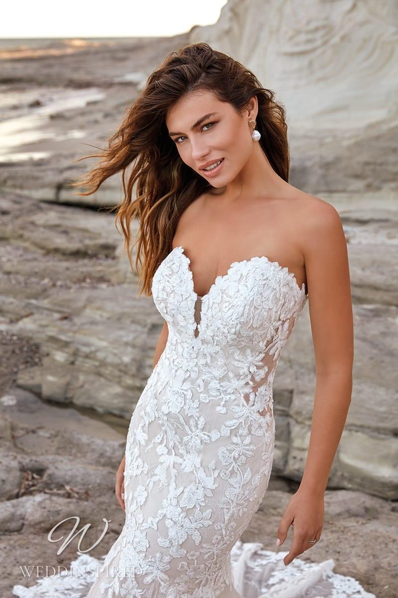 An Eddy K 2022 strapless lace mermaid wedding dress