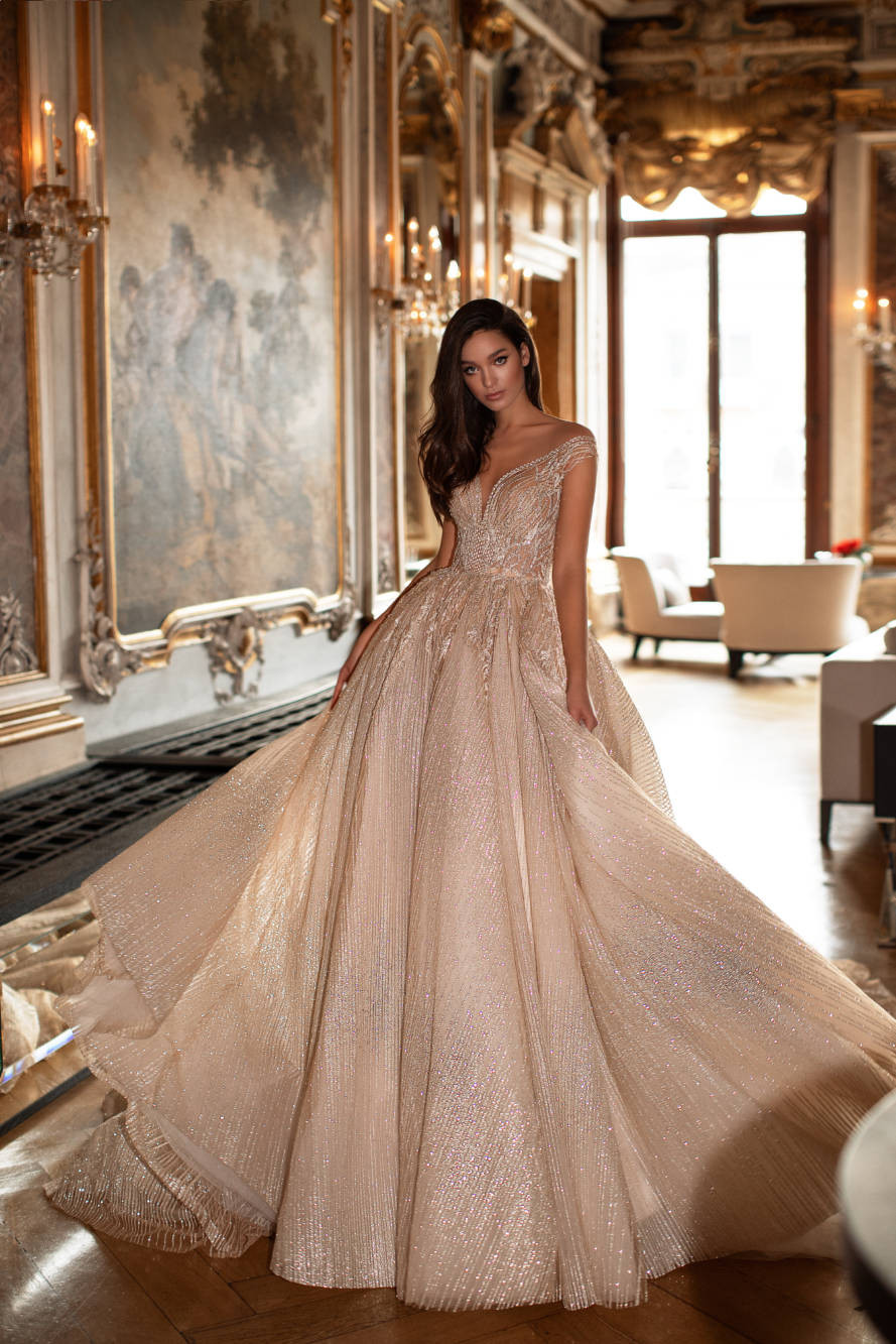 A Milla Nova blush champagne sparkly princess ball gown wedding dress