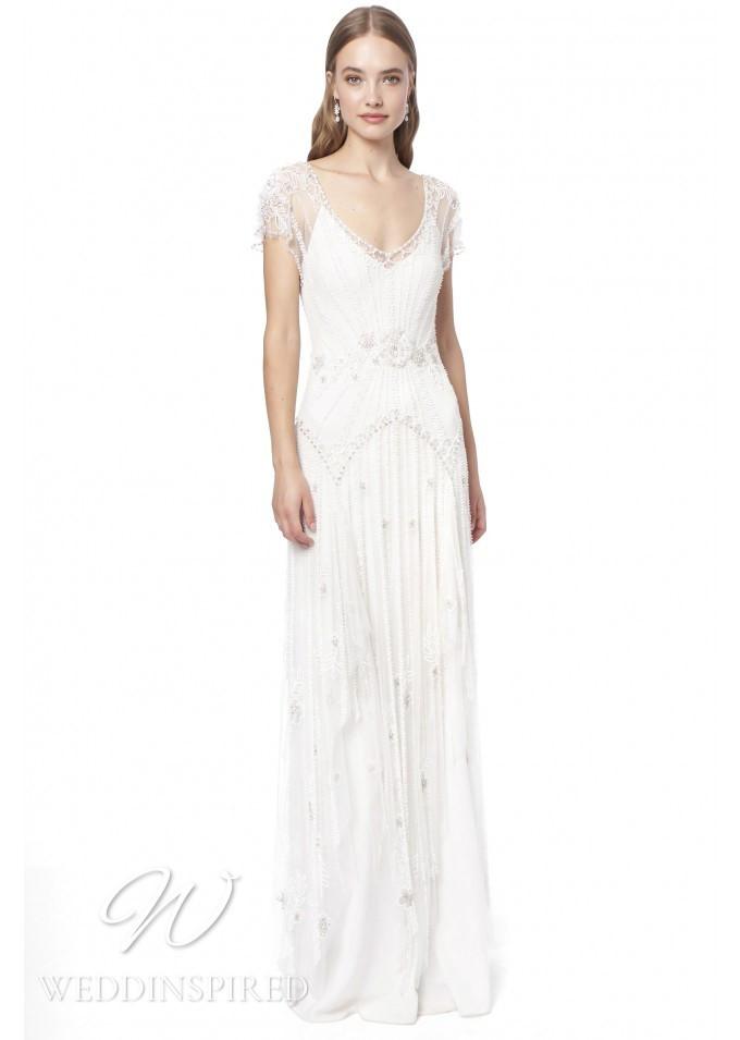 A Jenny Packham 2021 sparkly sheath wedding dress with cap sleeves