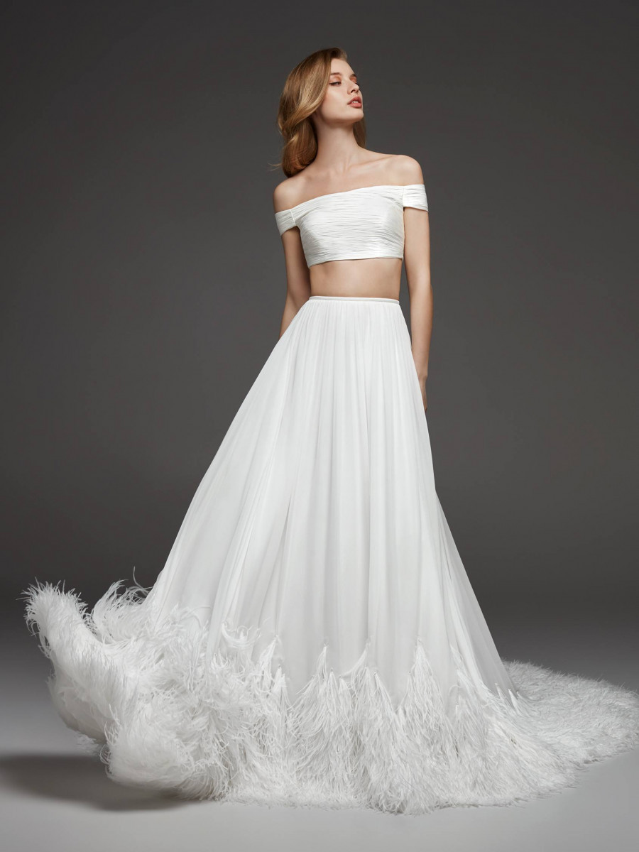 A Pronovias off the shoulder 2 piece crepe and feather A-line wedding dress