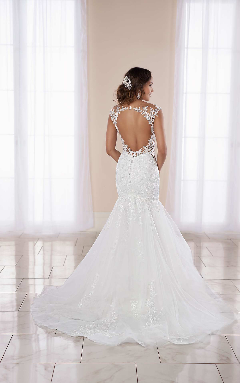 A Stella York 2020 lace and tulle mermaid fit and flare wedding dress with a keyhole back