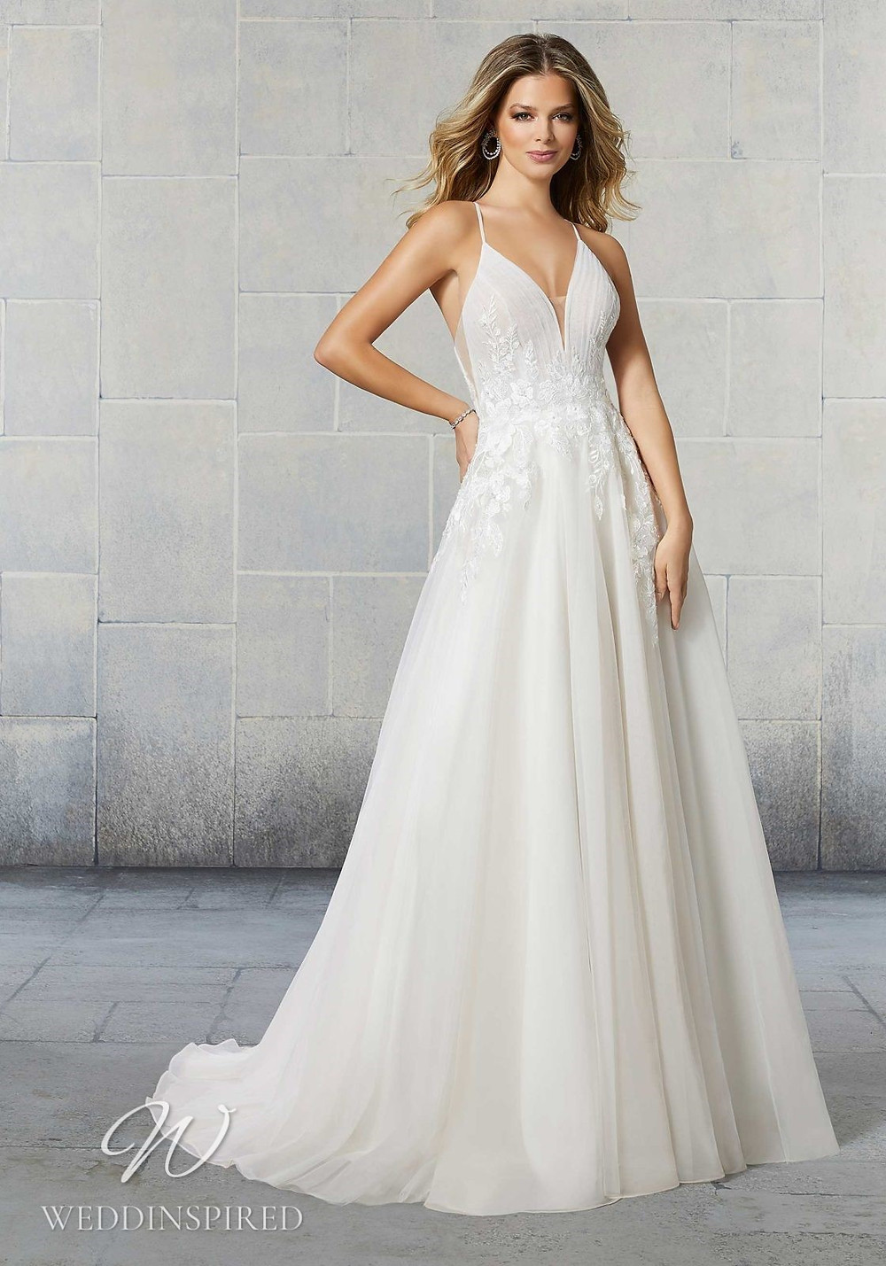 A Madeline Gardner tulle A-line wedding dress with straps