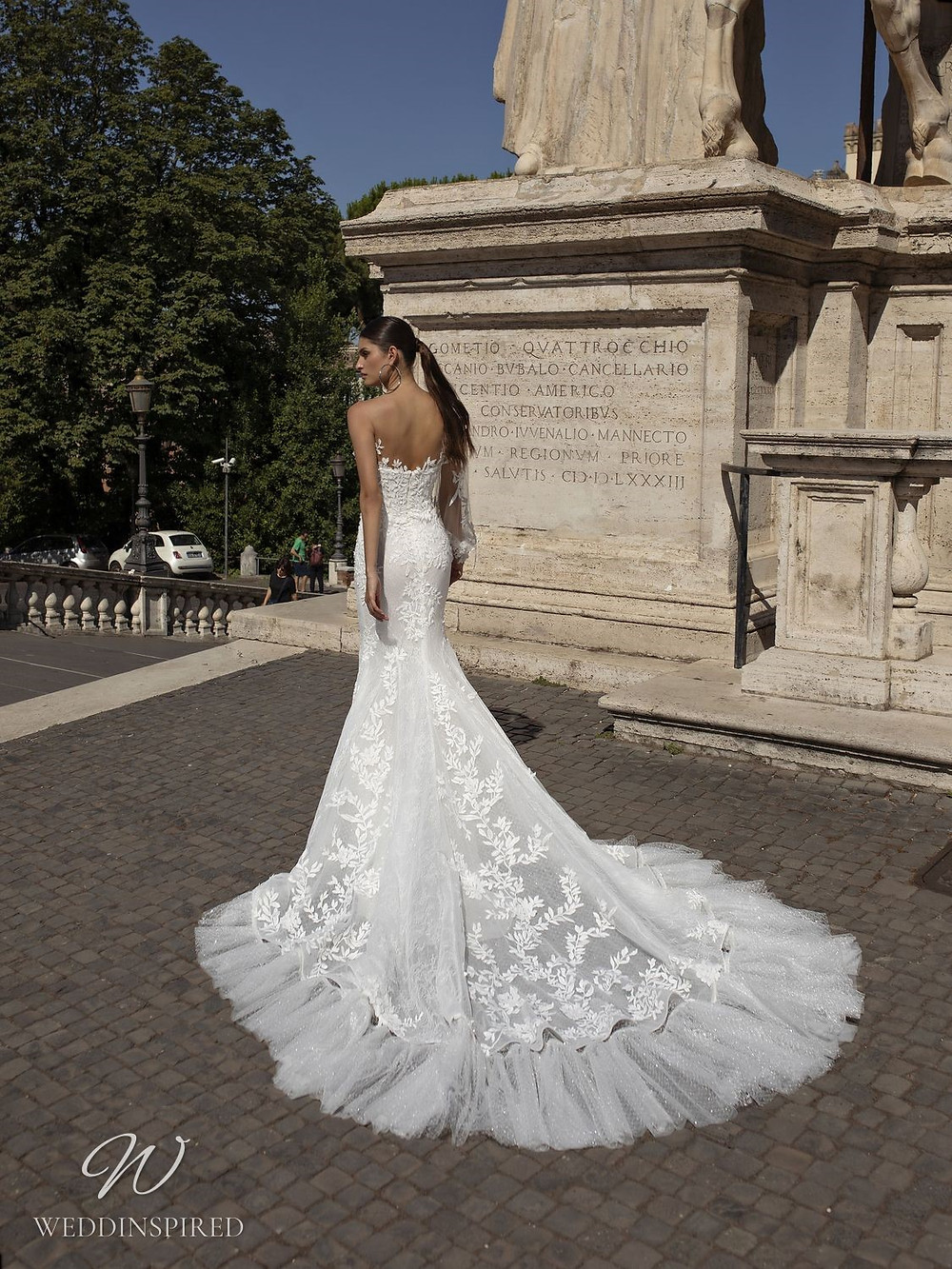 A Pinella Passaro one shoulder lace and tulle mermaid wedding dress with a train