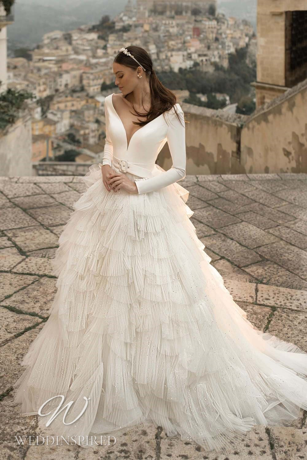 A Lussano 2021 satin and tulle A-line wedding dress with long sleeves