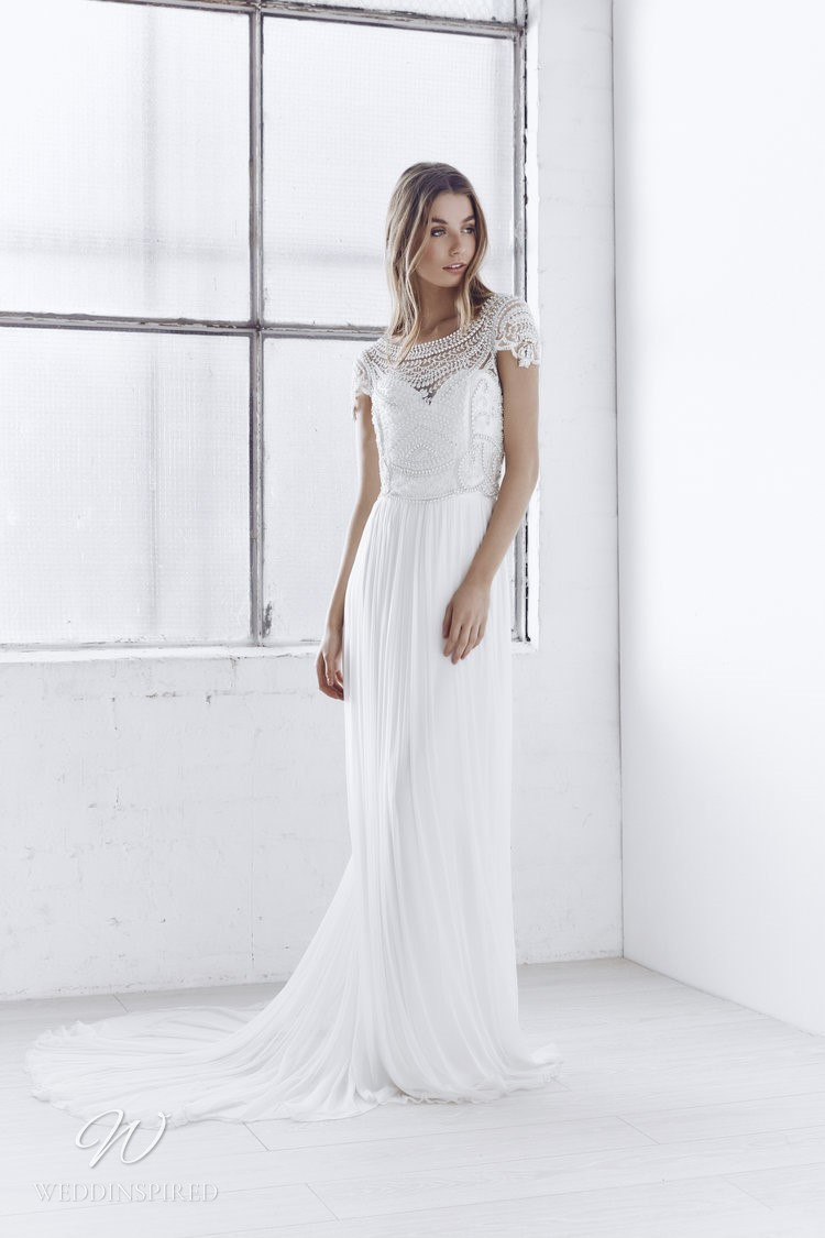An Anna Campbell 2020 grecian style sheath wedding dress with lace and chiffon
