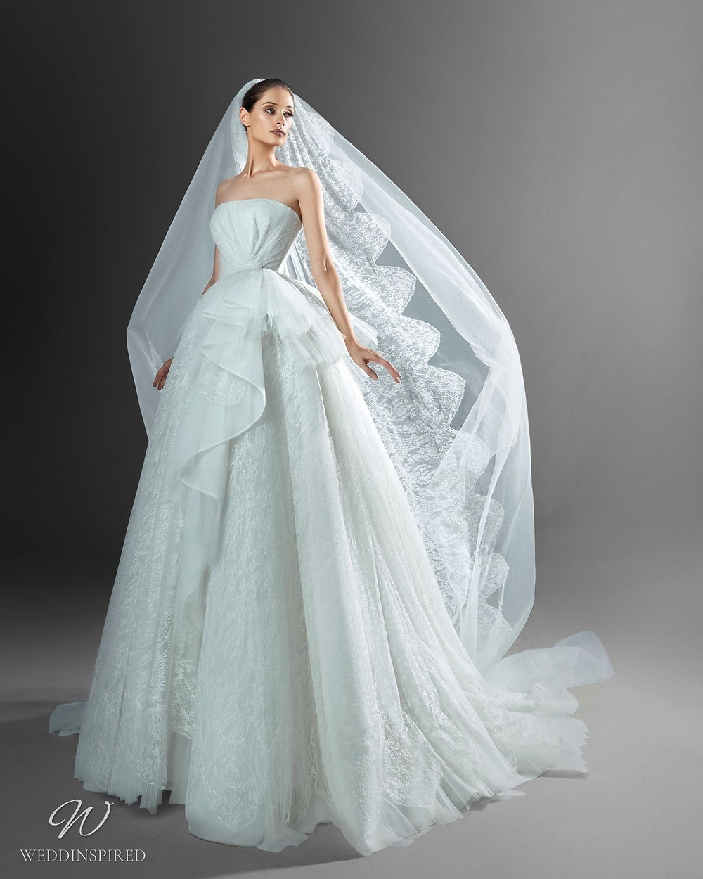 A Zuhair Murad strapless light blue princess ball gown Cinderella wedding dress with a tulle skirt and a veil