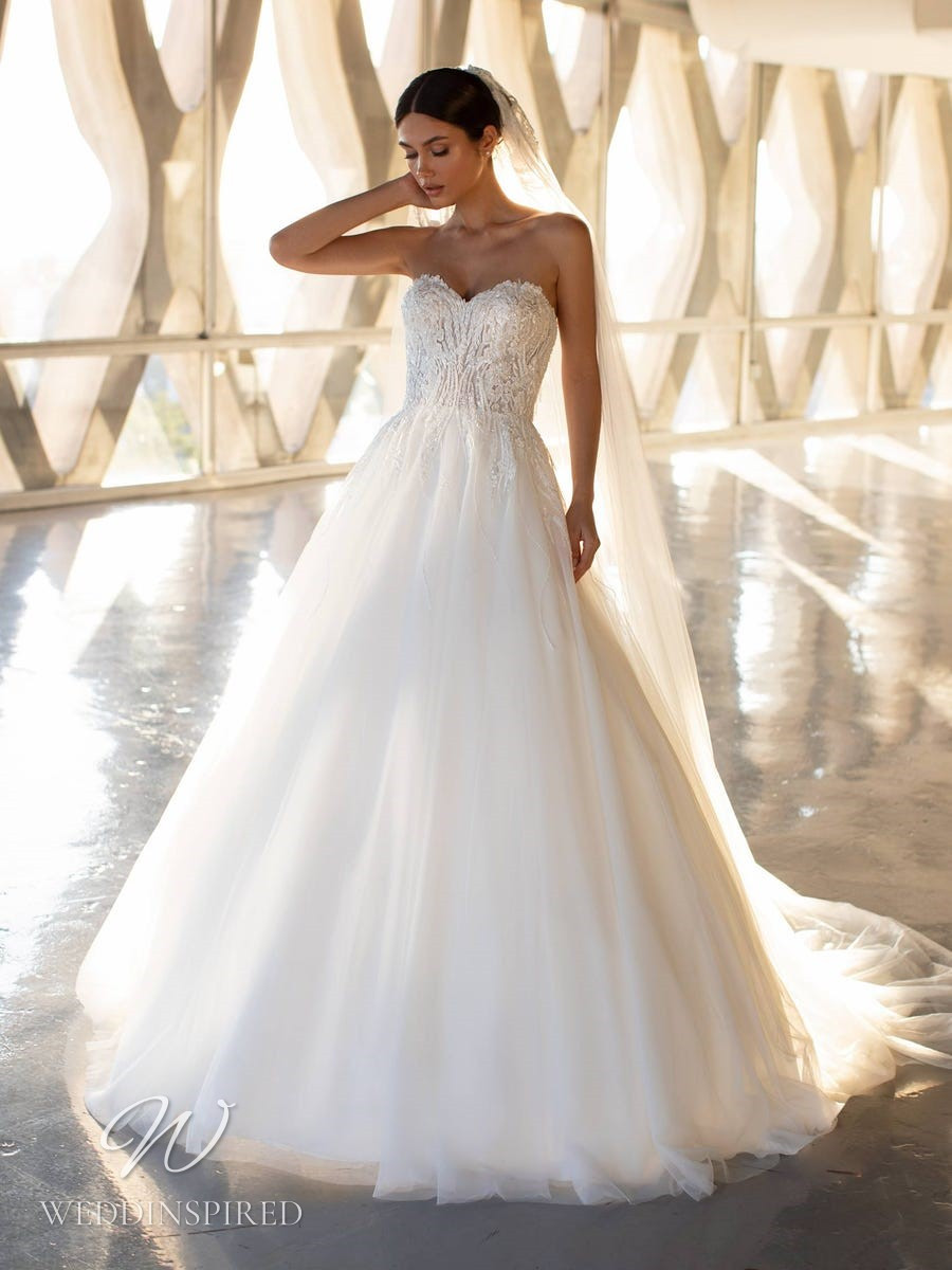 An Ashley Graham x Pronovias 2021 strapless lace and tulle ball gown wedding dress