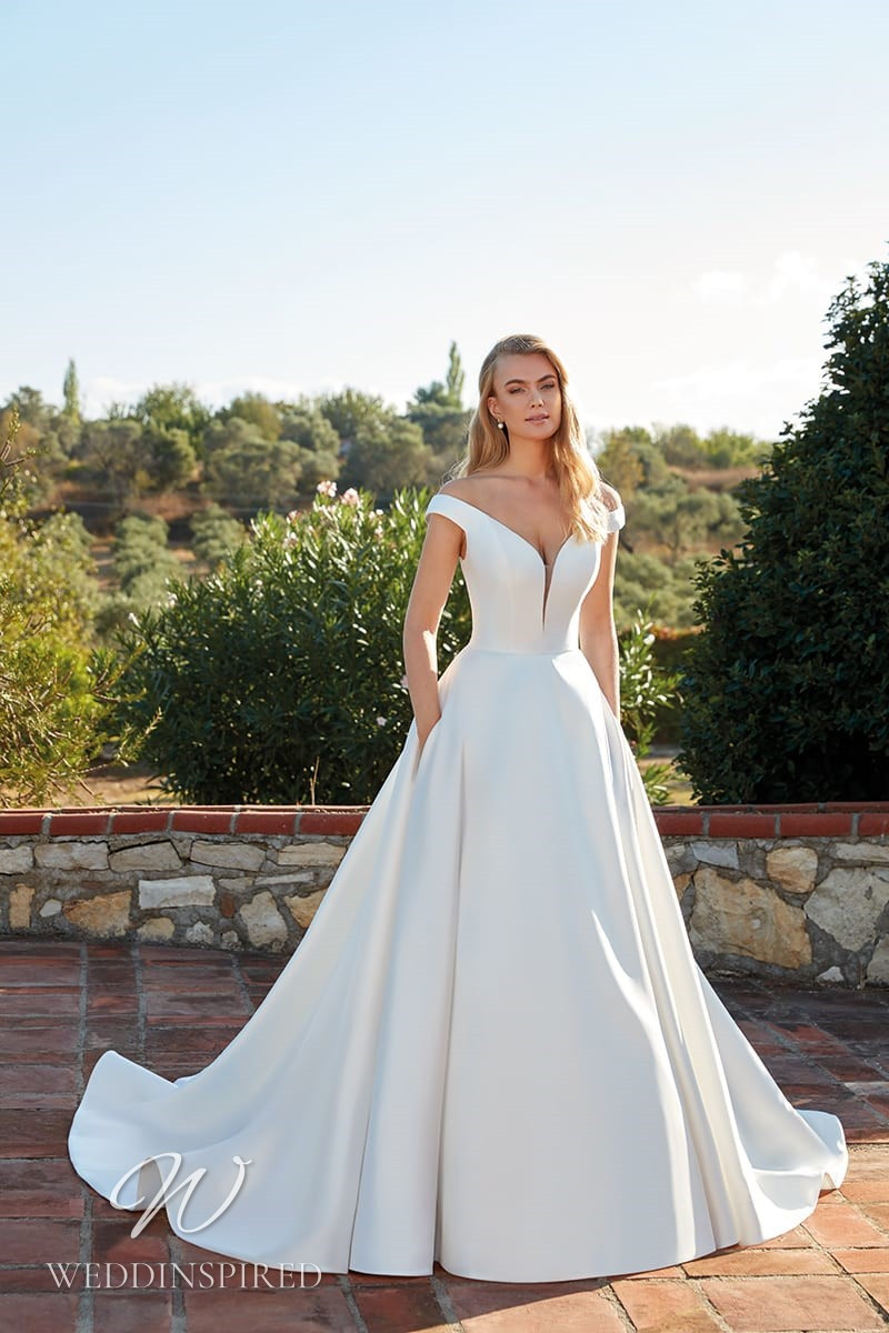 An Eddy K 2022 satin off the shoulder A-line wedding dress