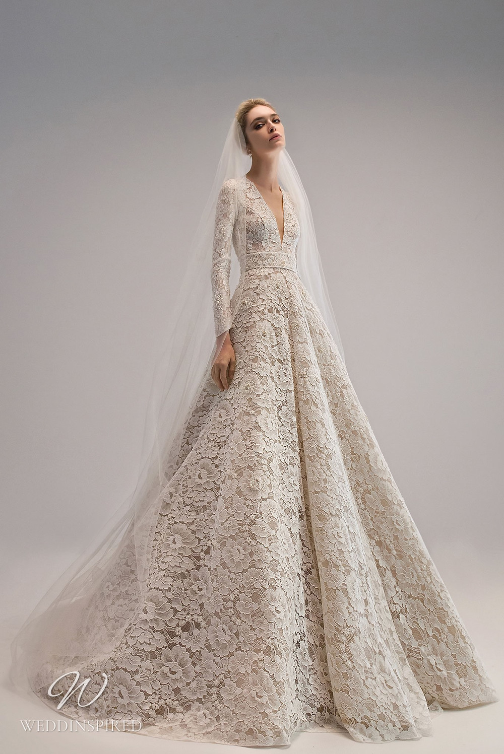 An Ersa Atelier 2021 lace ball gown wedding dress with long sleeves and a v neck