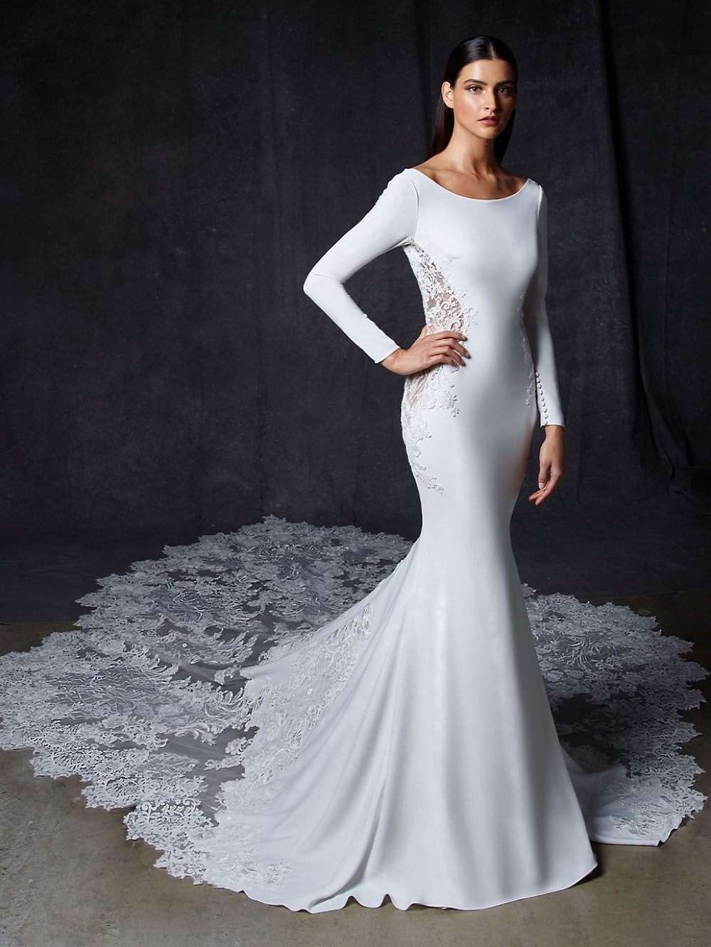 An Enzoani silk, long sleeve mermaid wedding dress with lace and a long train