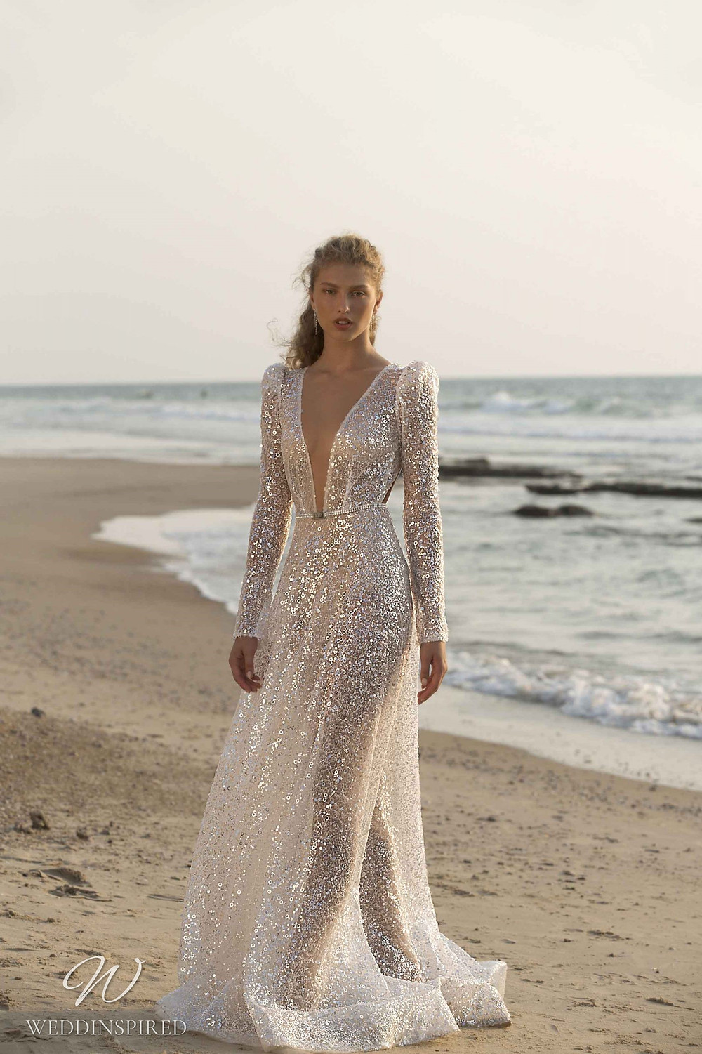 A Muse by Berta silver beach A-line wedding dress with long sleeves and a v neck