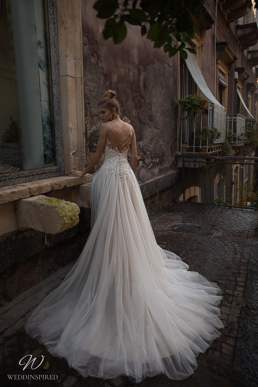 A Naviblue strapless lace and tulle A-line wedding dress
