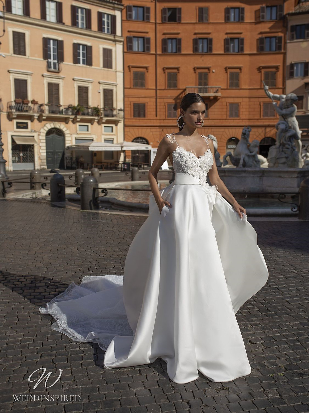 A Pinella Passaro silk satin ball gown wedding dress with a lace top