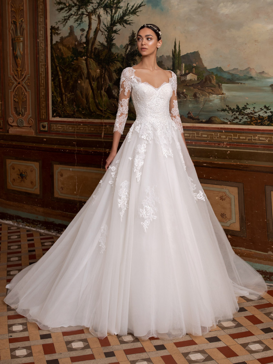 A Pronovias lace, 3/4 sleeve, ball gown wedding dress, with tulle skirt and sweetheart neckline