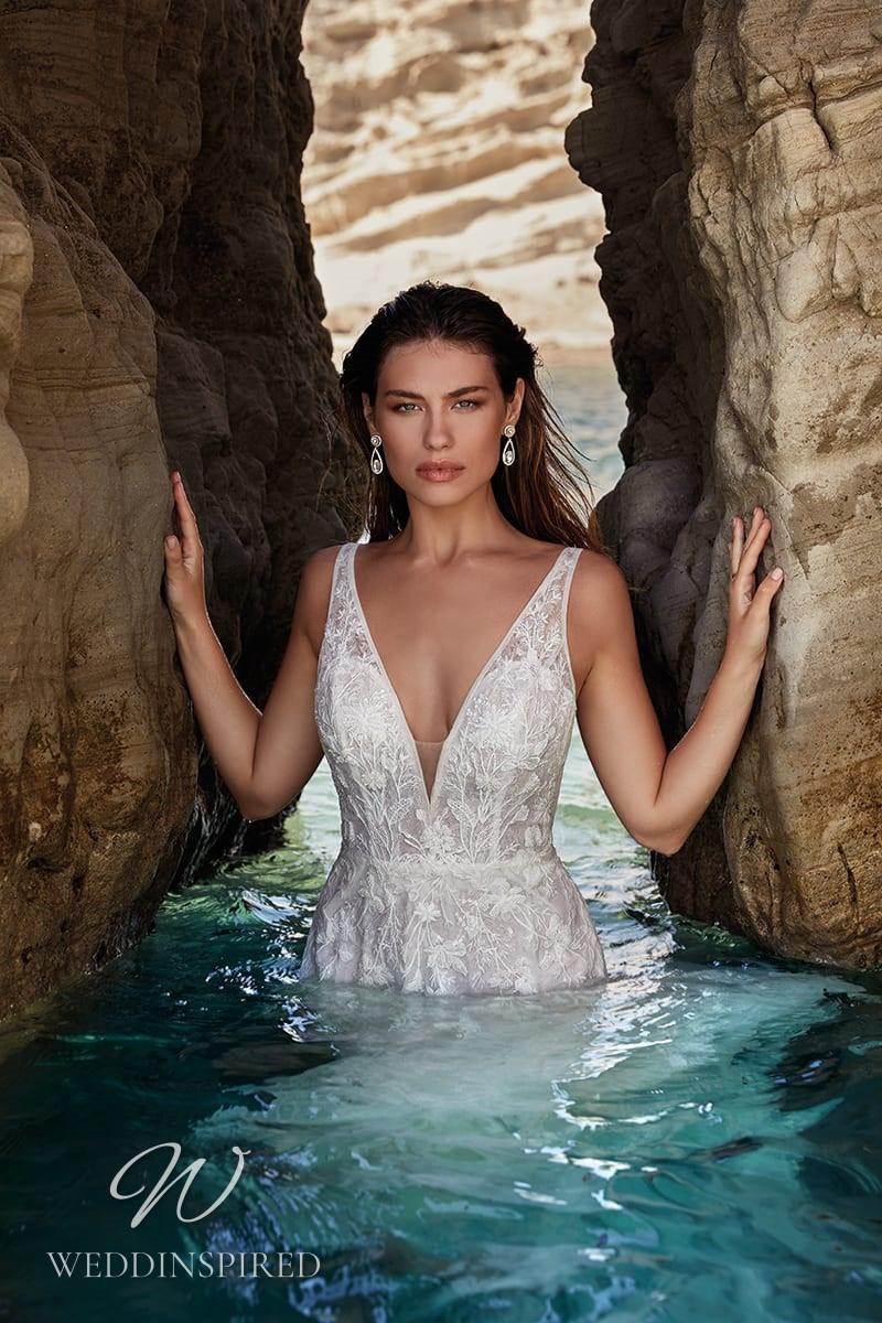 An Eddy K 2022 lace v neck mermaid wedding dress