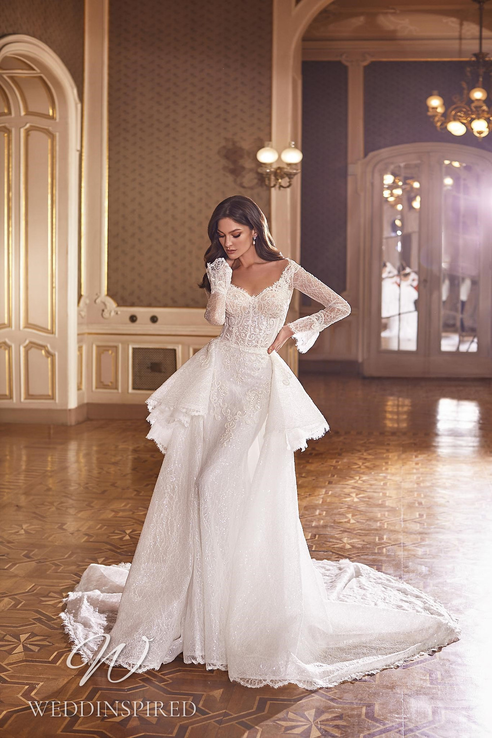 A Ricca Sposa 2022 lace mermaid wedding dress with long sleeves and a detachable skirt