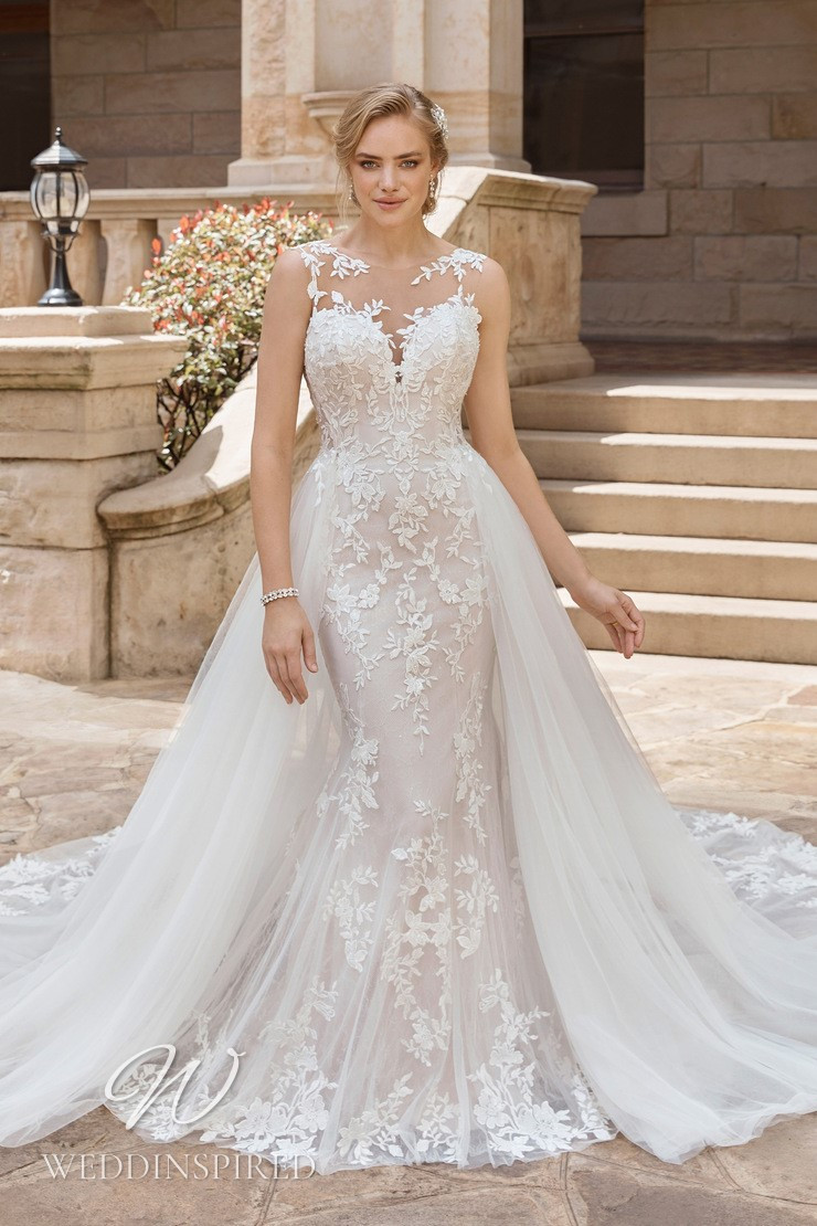 A Sophia Tolli 2021 lace and tulle mermaid wedding dress with a detachable skirt