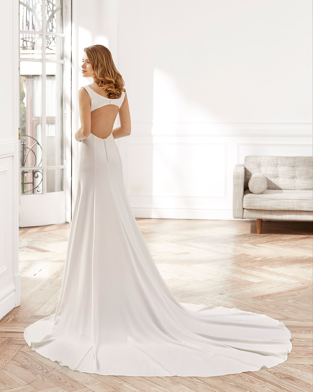 An Aire Barcelona 2020 simple crepe A-line wedding dress with a keyhole back