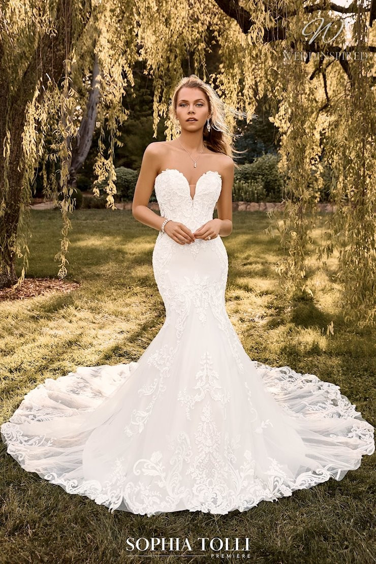 A Sophia Tolli strapless lace mermaid wedding dress with a train
