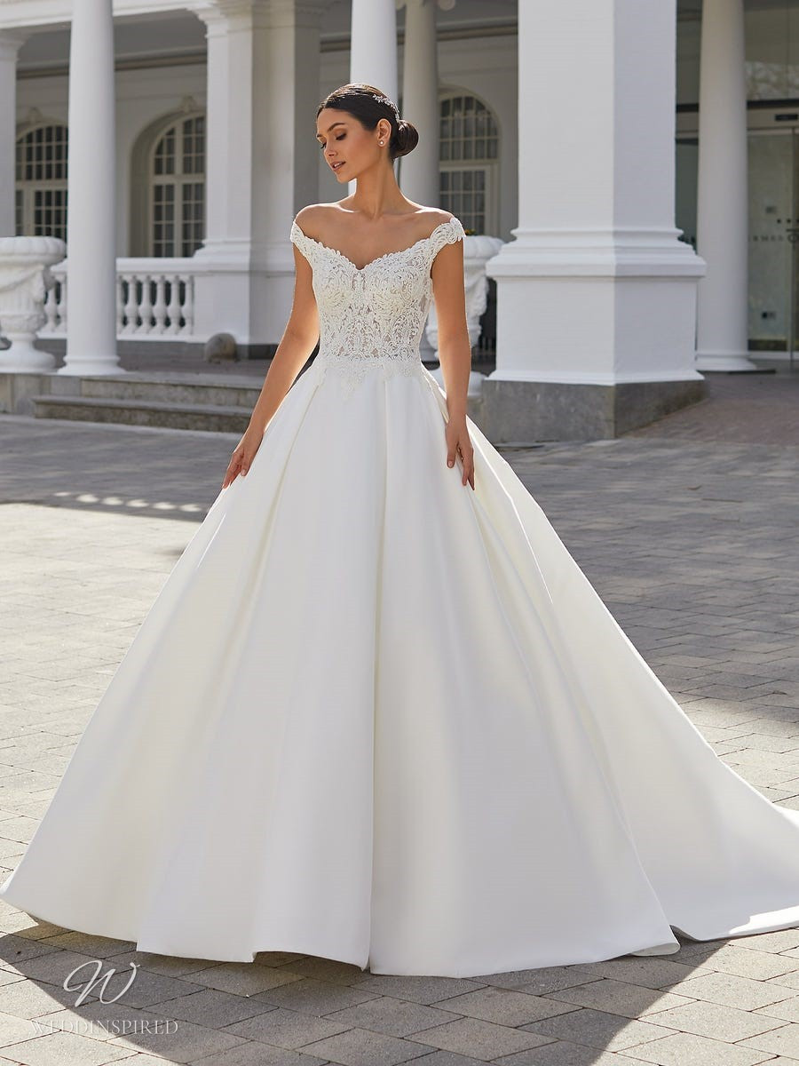 A Pronovias 2021 off the shoulder lace and crepe ball gown wedding dress