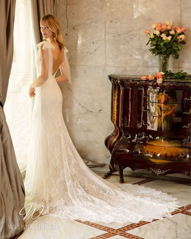 A Rosa Clara 2021 lace mermaid wedding dress with bows