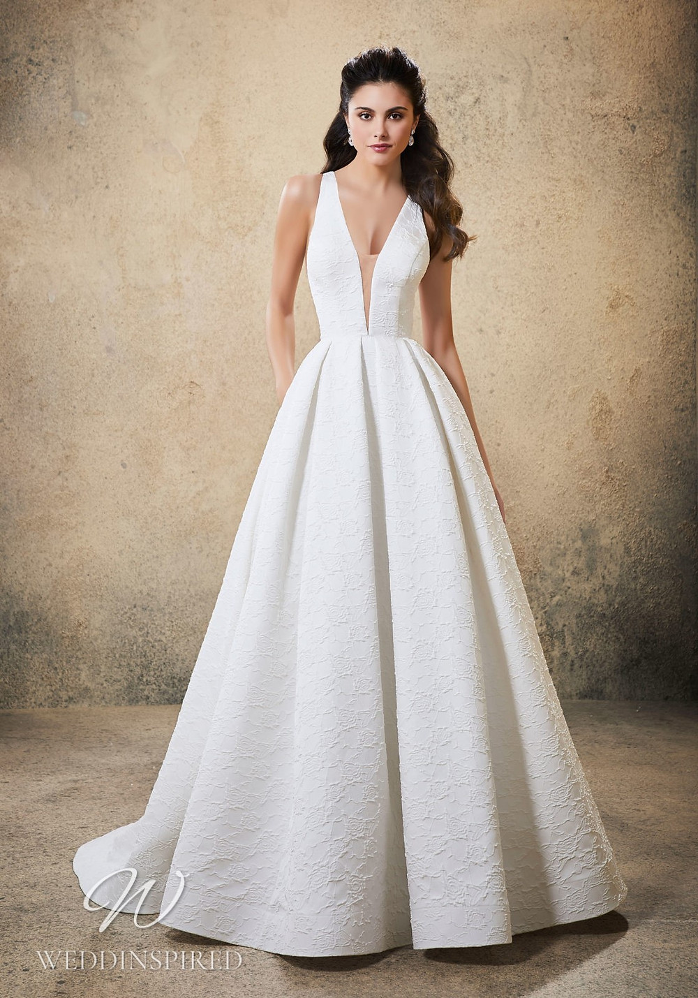 A Madeline Gardner simple A-line wedding dress with a v neck and pockets