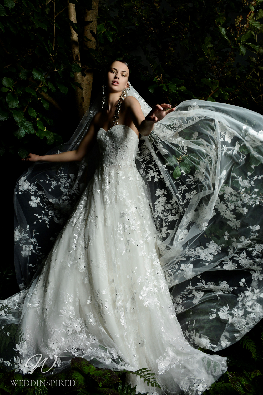A Naeem Khan Fall 2021 strapless lace A-line wedding dress with a sweetheart neckline