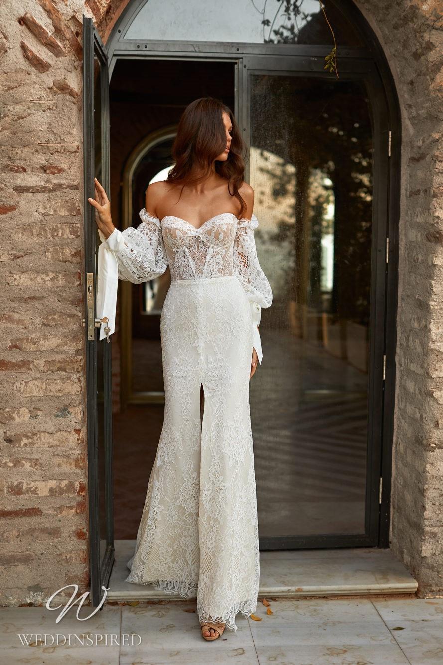 A Milla Nova 2021 ivory lace off the shoulder boho mermaid wedding dress with long sleeves