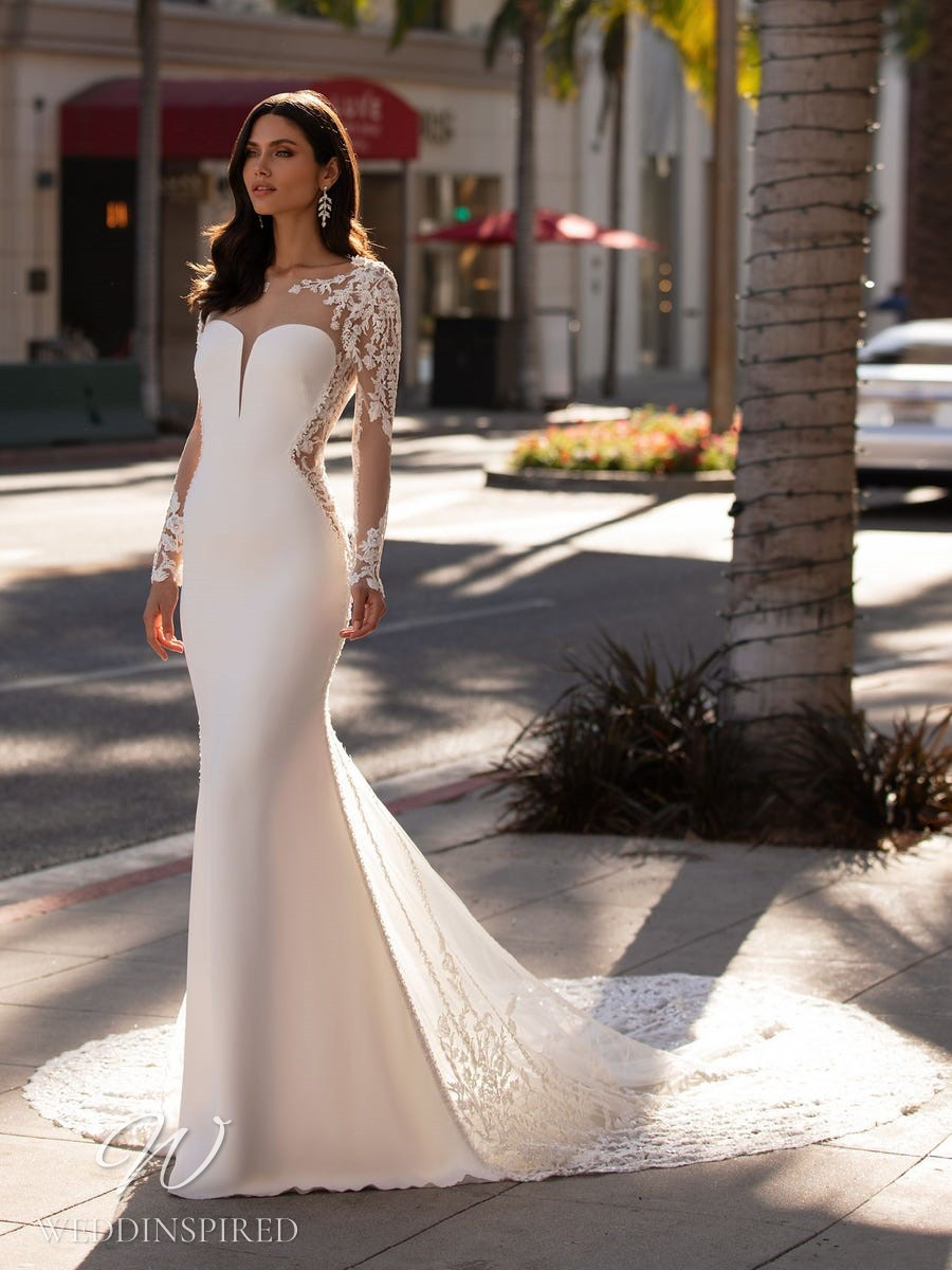 A Pronovias 2021 satin and lace mermaid wedding dress with long sleeves