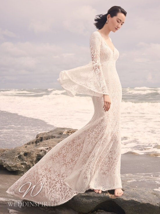 A Sottero & Midgley Spring 2021 lace mermaid wedding dress with long bell sleeves and a v neck