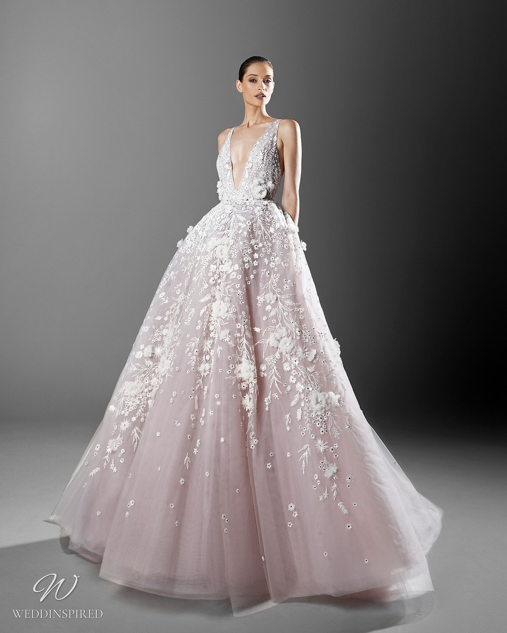 A Zuhair Murad romantic blush princess ball gown wedding dress with a tulle skirt and flowers