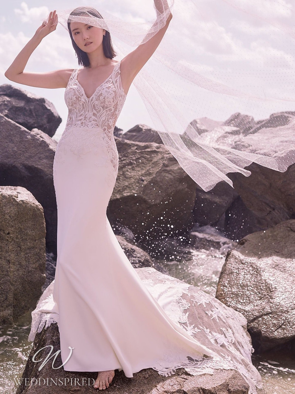 A Sottero & Midgley Spring 2021 lace and crepe mermaid wedding dress with a v neck and straps