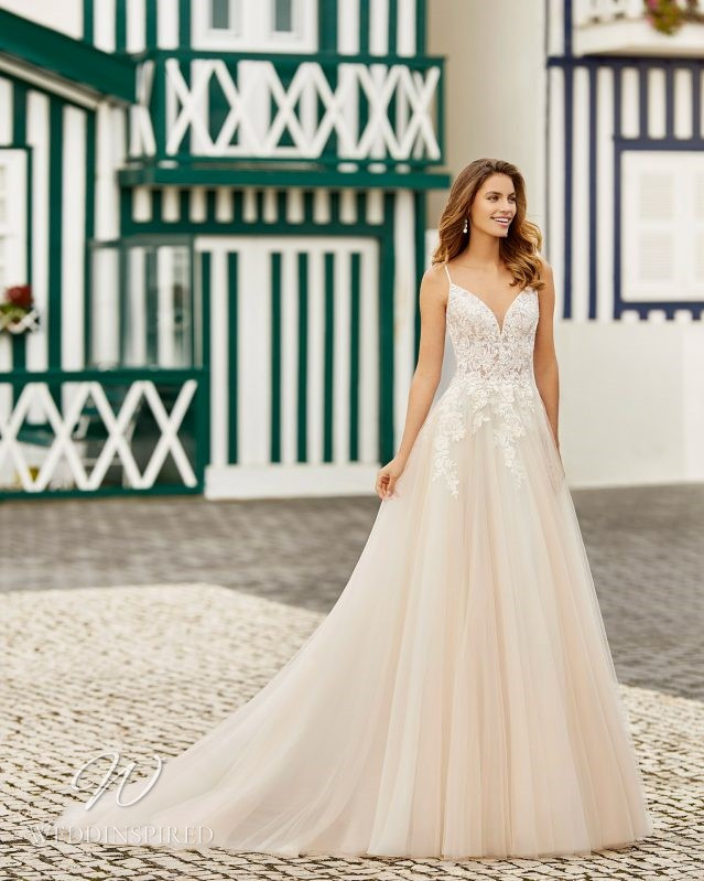 A Rosa Clara 2021 blush lace and tulle A-line wedding dress