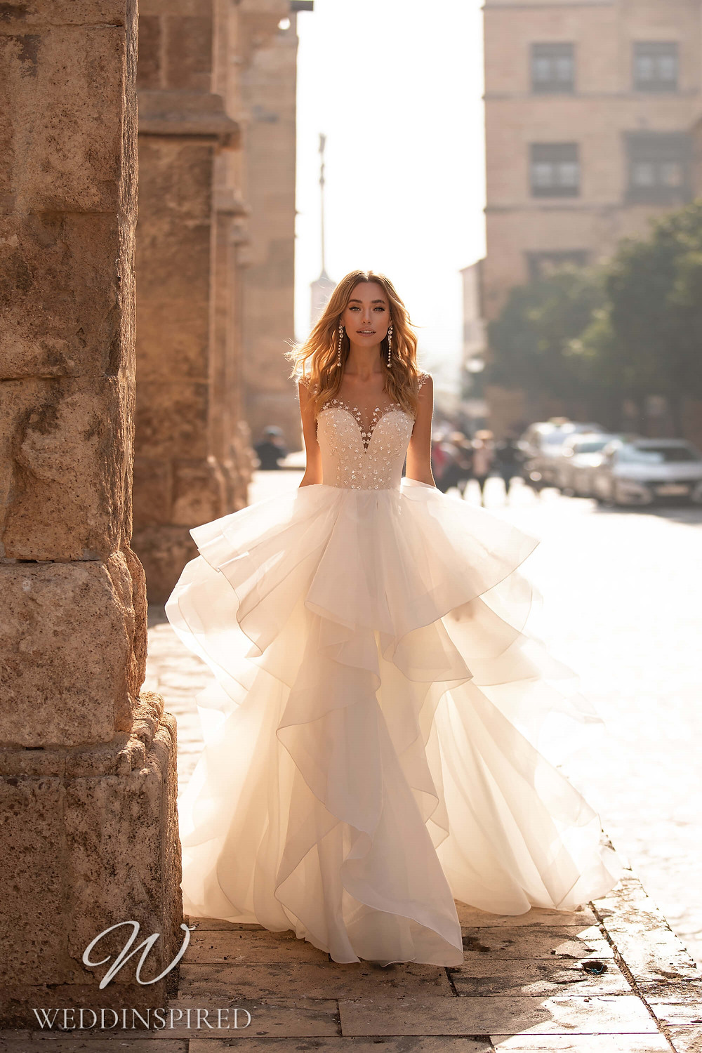 An Essential by Lussano 2021 tulle princess wedding dress with a ruffle skirt