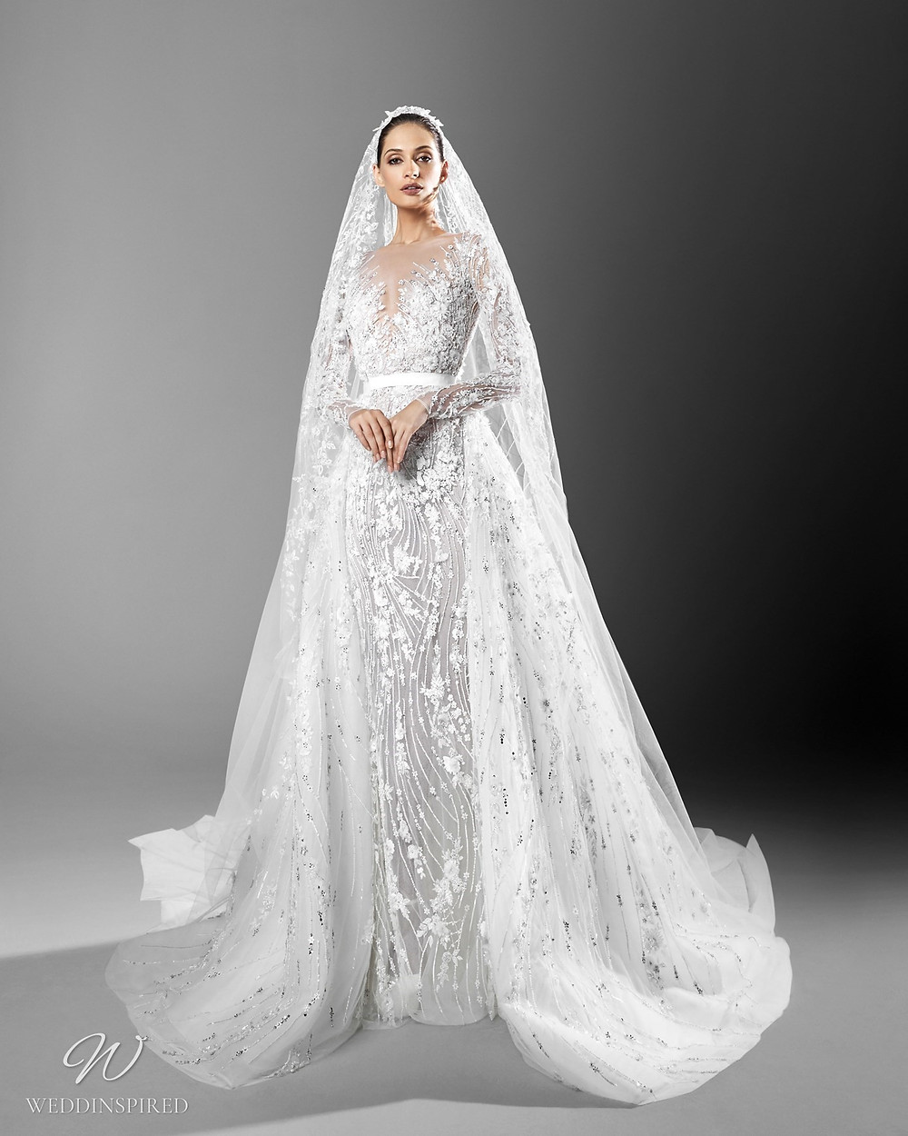 A Zuhair Murad crystal embellished mermaid wedding dress with a detachable skirt and veil