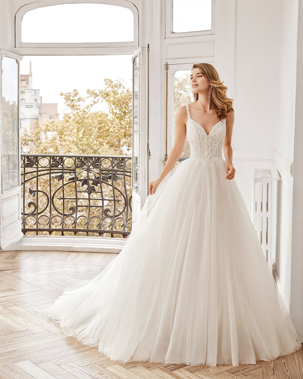 An Aire Barcelona 2020 lace and tulle ball gown wedding dress with straps