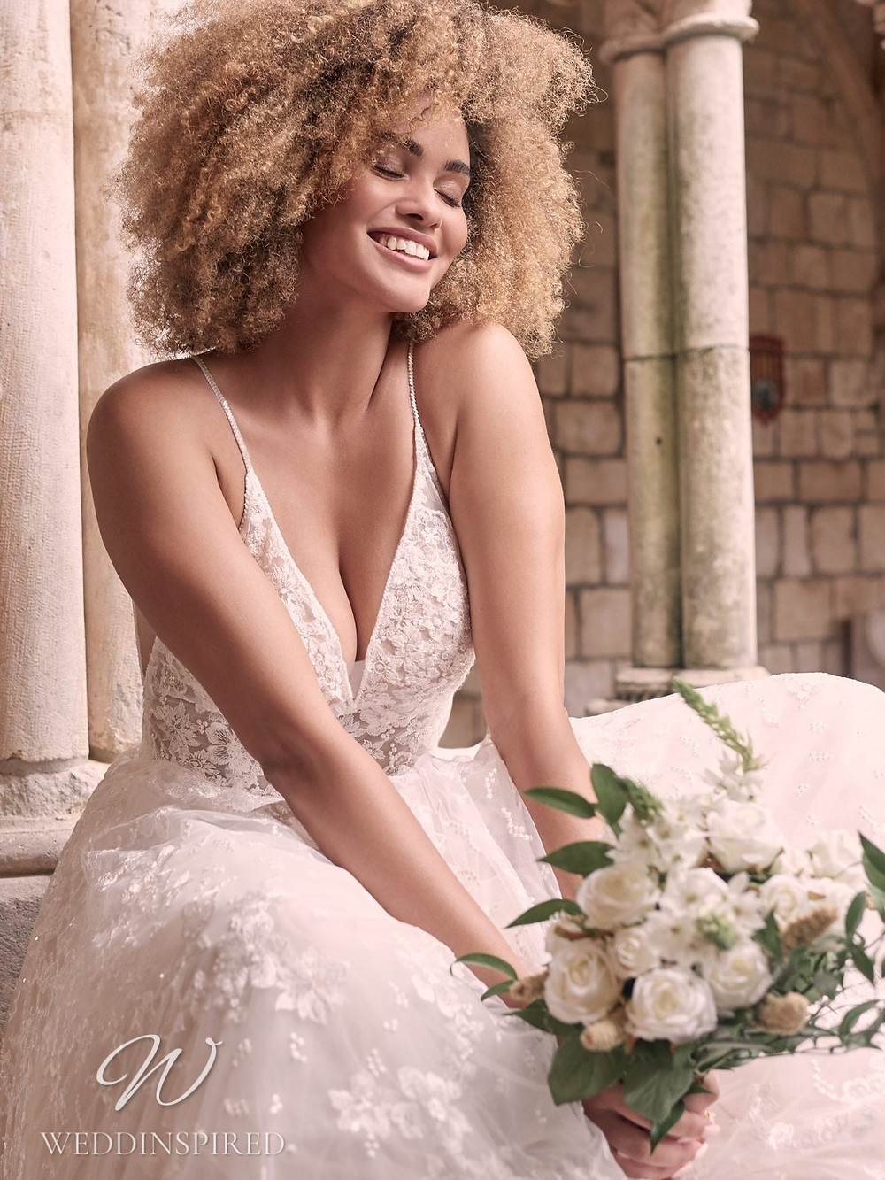 A Maggie Sottero Spring 2021 lace A-line wedding dress with straps and a v neck