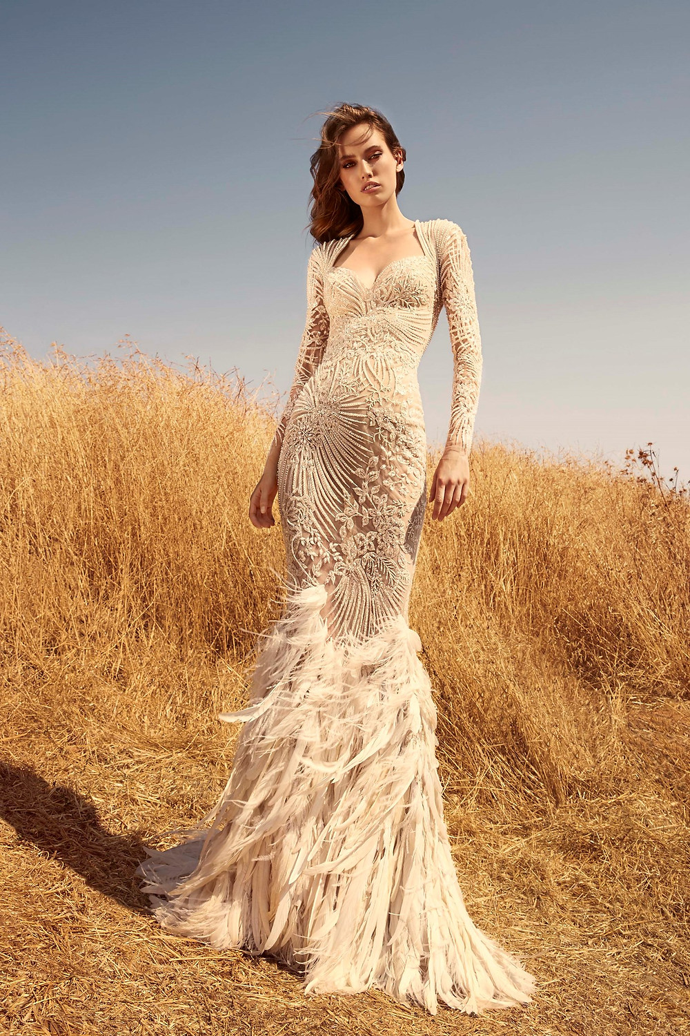 A Zuhair Murad blush lace and feather mermaid wedding dress with long sleeves