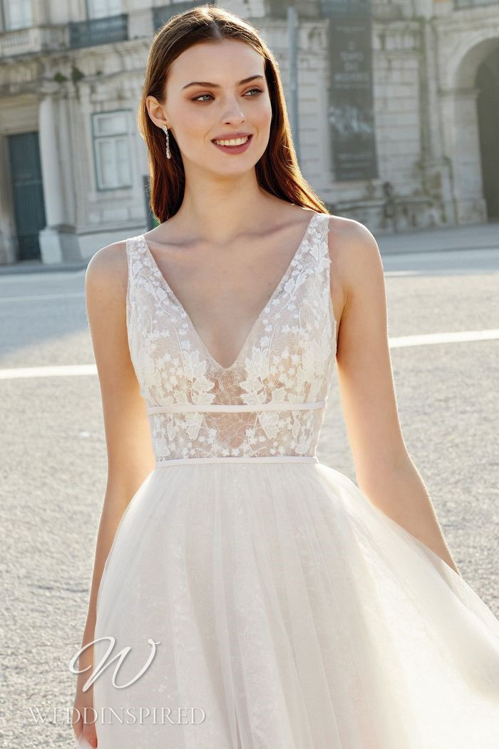 A Justin Alexander 2021 lace and tulle A-line wedding dress with a v neck