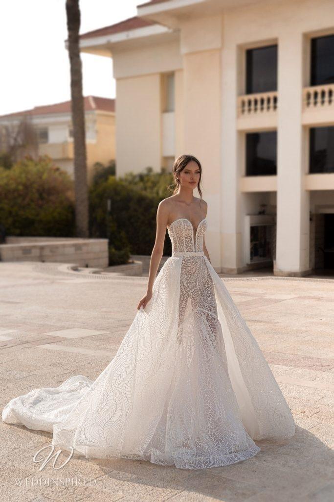 An Eden Aharon 2020 sparkly strapless mesh mermaid wedding dress with a detachable skirt