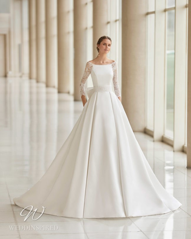 An Aire Barcelona 2021 lace and satin princess ball gown wedding dress with pockets and long sleeves
