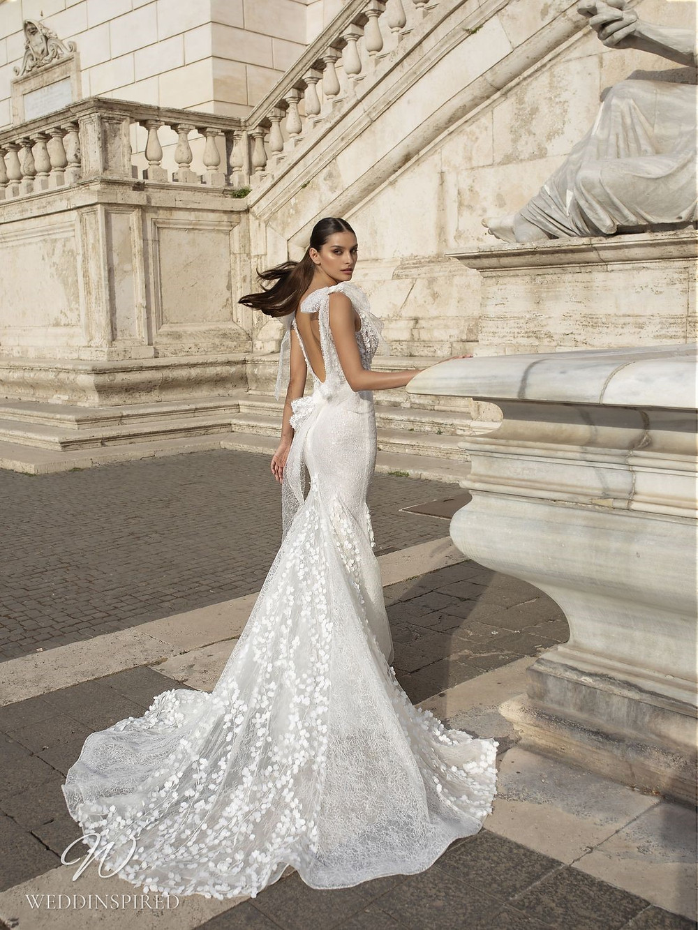 A Pinella Passaro lace mermaid wedding dress with a low back and bows
