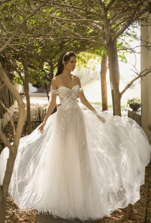A David Hasbani lace and tulle off the shoulder strapless ball gown wedding dress