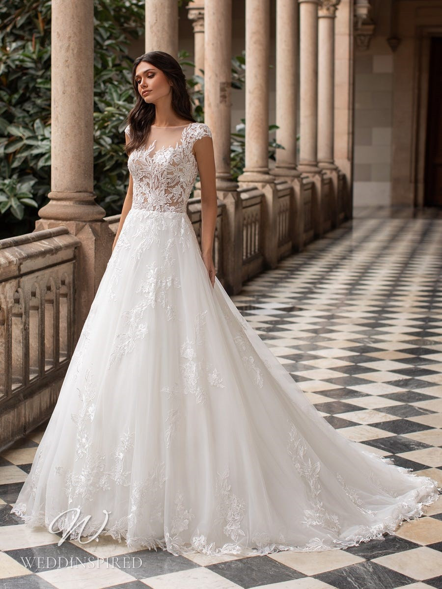 A Pronovias 2021 lace princess ball gown wedding dress with cap sleeves