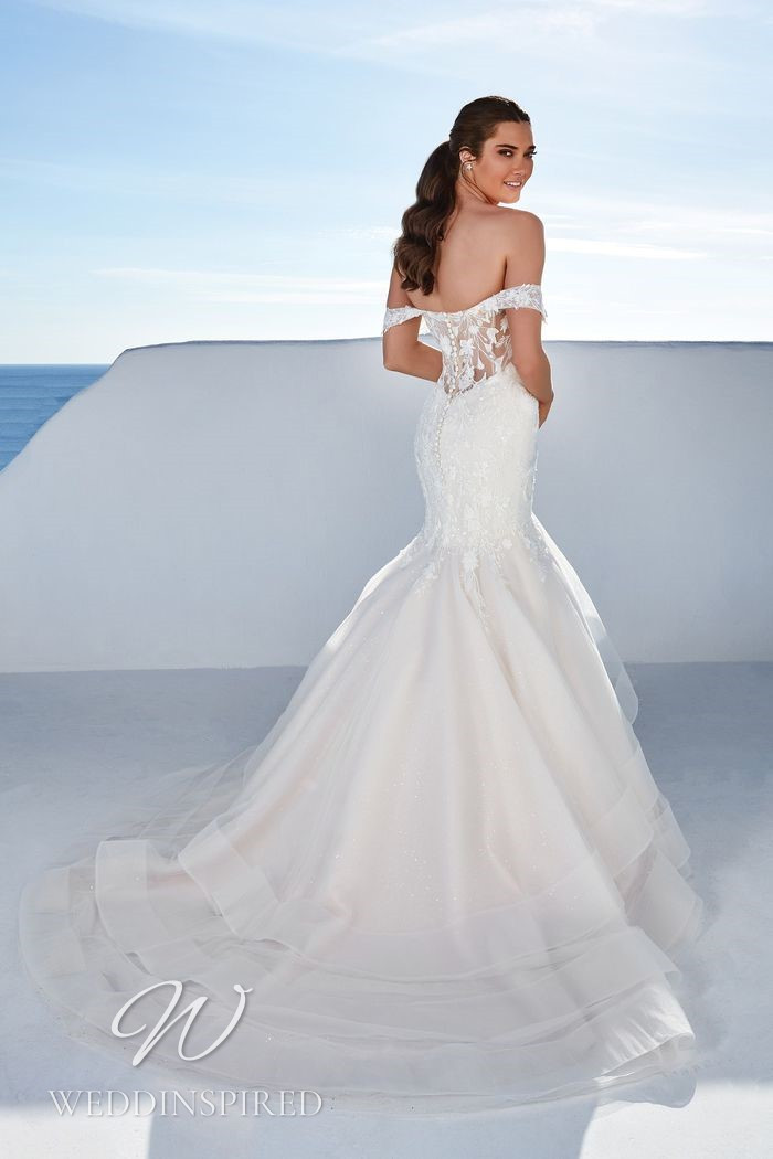 A Justin Alexander 2021 off the shoulder lace and tulle mermaid wedding dress