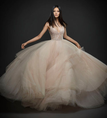 A Lazaro blush tulle princess ball gown wedding dress