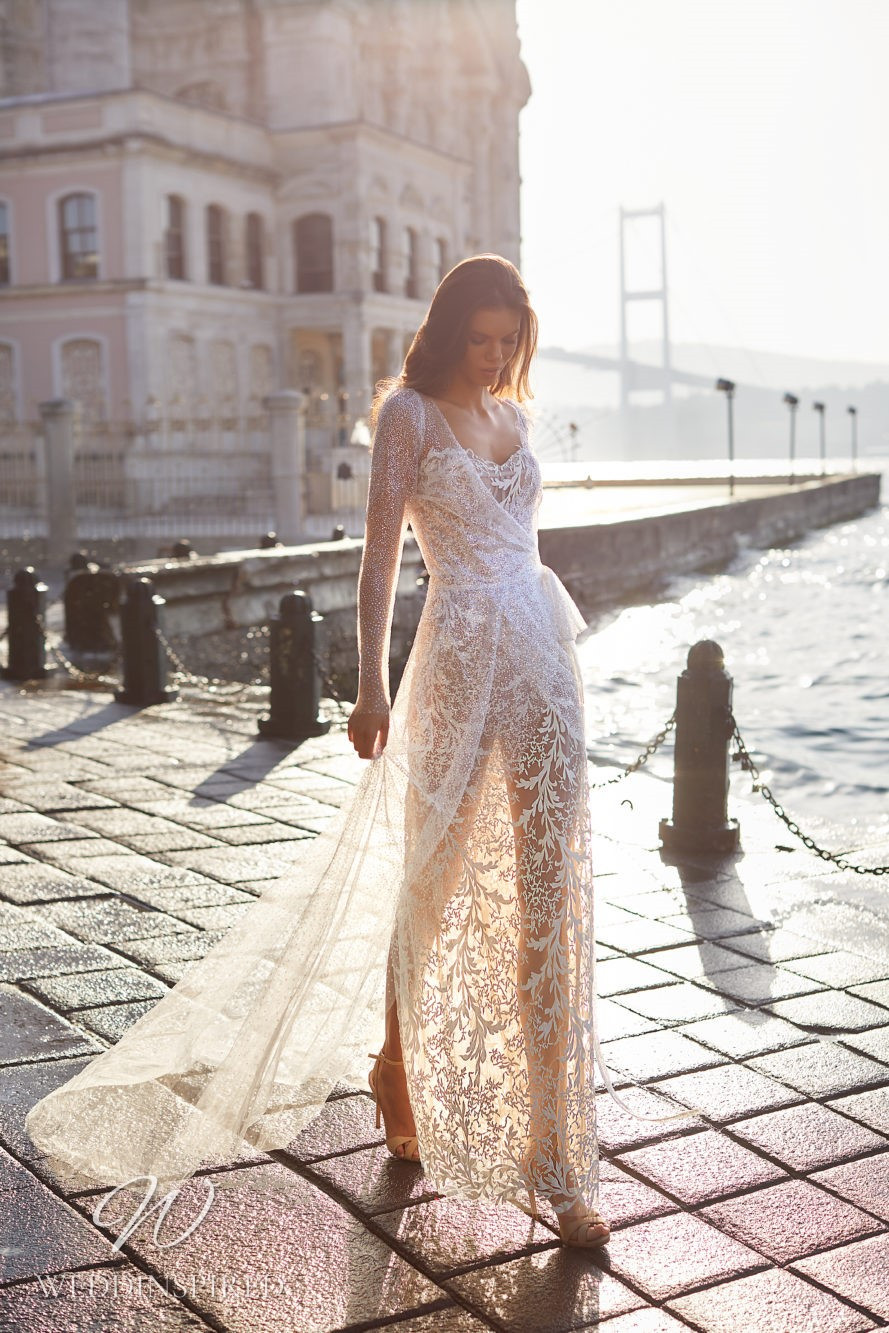 A Milla Nova 2021 sparkly blush lace and mesh sheath wedding dress with long sleeves